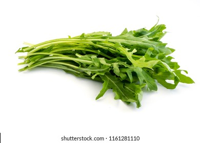 Bundle of green arugula isolated on white background