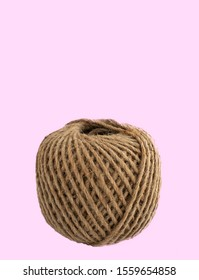 Bundle of hemp rope isolated on pink background. Hemp rope is a natural material for handcraft or handwork. A natural fiber material is old but eco-friendly. AKA, manila fiber. Eco packaging concept.