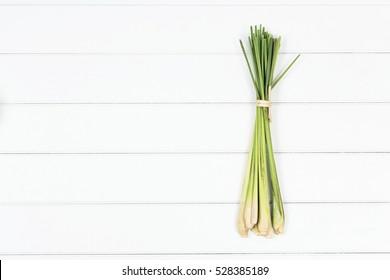 bundle of lemon grass on white wood background, top view lemon grass photography.