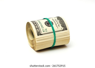A bundle of money with green rubber band