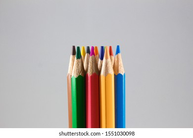 Bundle of rainbow colored pencils with selected focus on tips