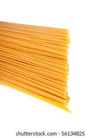 bundle of raw spaghetti over white background