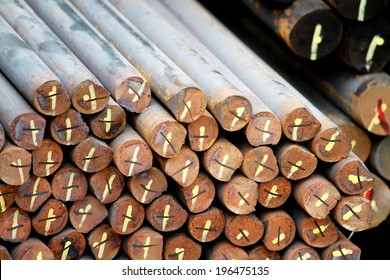 The bundle of rust steel rod in warehouse
