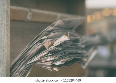 A bundle of sheets of paper in a drawer