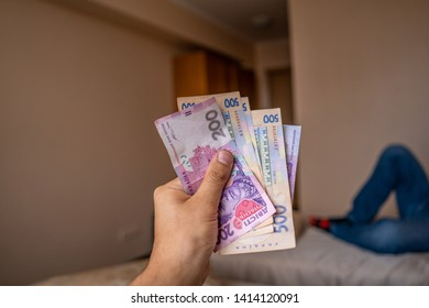 Bundle of Ukrainian money (hryvnia, grivna) in the hands of old man