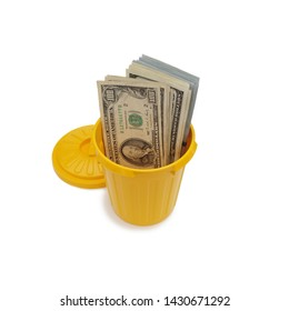 Bundle Of US $100 Bills Stuffed In Yellow Trash Can Container Isolated Over White Background