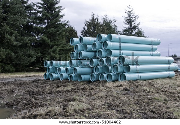Bundles of blue PVC pipe ready for the sewer or water line.