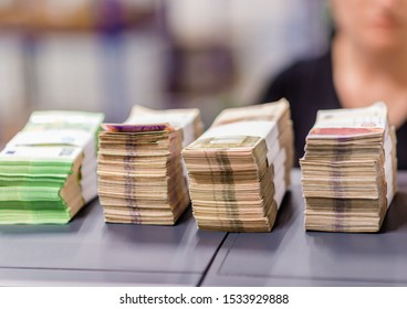 Bundles of euro € money financial picture, female cash desk worker counting money, euro banknote in treasury department for cash machine refill