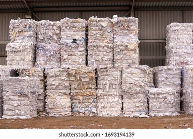 Bundles of shredded paper at recycling facility