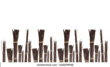 Bundles of wood twig sticks isolated on white background