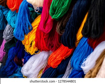 Bundles of yarn in various colors.