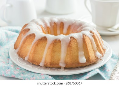 Bundt Cake  with Sugar Glaze on white background