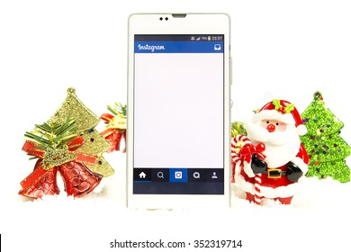 BUNG KAN, THAILAND - DECEMBER 16, 2015: Instagram app on smart phone screen in Christmat theme