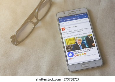 BUNG KAN, THAILAND - FEBRUARY 05, 2017: smart phone display facebook news feed about Donald Trump with Like button