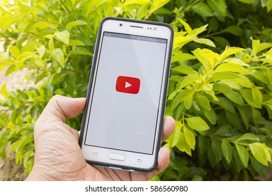 BUNG KAN, THAILAND - FEBRUARY 21, 2017: smart phone display youtube app with nature background