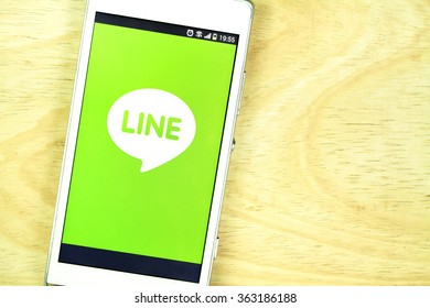 BUNG KAN, THAILAND - JANUARY 15, 2016: smart phone display line app on office desk