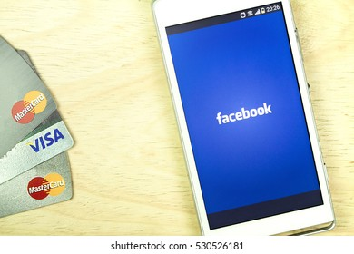 BUNG KAN, THAILAND - JANUARY 15, 2016: smart phone display facebook app and credit card on office desk, selective focused