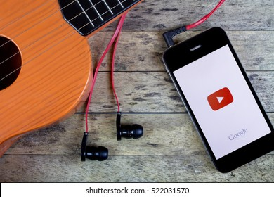 BUNG KAN, THAILAND - OCTOBER 25, 2015: Smart phone and Guitar, earphones and youtube app on screen