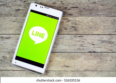 BUNG KAN, THAILAND - SEPTEMBER 02, 2015: smartphone on the table and line on screen