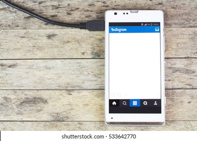 BUNG KAN, THAILAND - SEPTEMBER 02, 2015: smart phone and instagram app on screen and charging battery