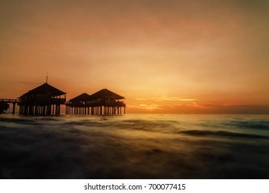 Bungalow on the water during sundown at Singaraja, Northern Bali