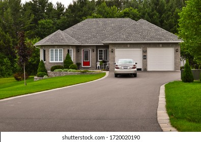 Bungalow / ranch house with a lawn and driveway