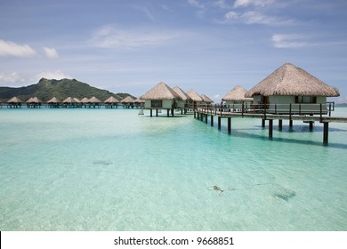 Bungalows over gorgeous Bora Bora lagoon.