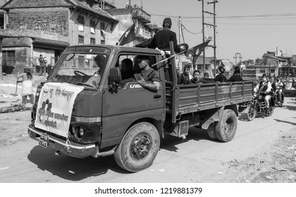 BUNGAMATI, NEPAL - NOV 4: Unidentified people on a truck taking part in a street demonstration on Nov 4, 2013 in Bungamati, Nepal. Political demonstrations are common in Nepal.