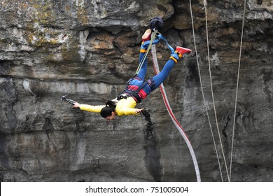 Bungee jumps, extreme and fun sport. Bungee in a cave.