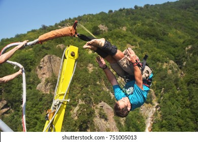 Bungee jumps, extreme and fun sport. Athlete performs tricks