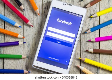 BUNGKAN, THAILAND - NOVEMBER 10, 2015: smart phone with Facebook login on screen and color pencil around