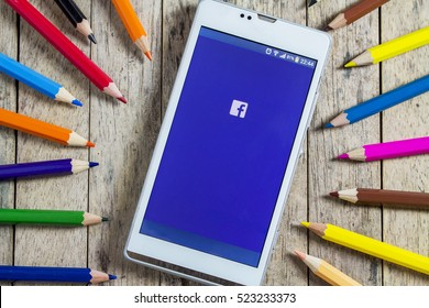 BUNGKAN, THAILAND - NOVEMBER 10, 2015: smart phone with Facebook on screen and color pencil around