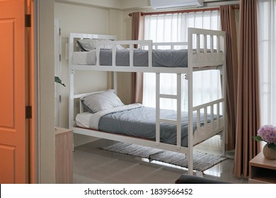 Bunk bed. A dormitory with bunk bed bu the window. Window light. film grained filter.