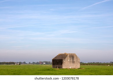 Bunker, concrete fortification of the second world war, in a meadow in the Dutch landscape.
