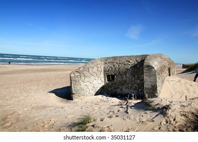 bunker on beach. german army fortification by danish coast from world war 2