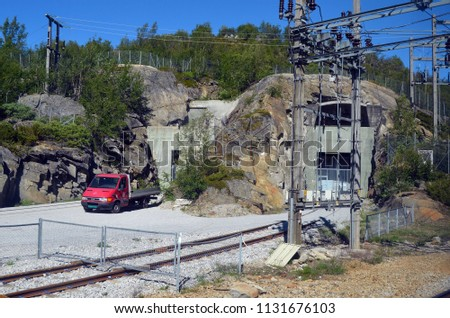 A bunker with railway tracks in the depth of the mountain range. Railway travel in Norway.Views from the train. June 26,2018. The Bergen - Oslo train. Norway