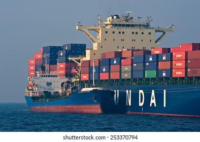 Bunkering tanker Russian Island container ship Hyundai company. Nakhodka Bay. East (Japan) Sea. 19.04.2014