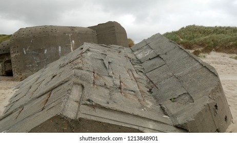 bunkers and concrete constructions on the beach in the Danish part of the Atlantic Wall. It was a coastal defense line along the west coast of Jutland in the second world war.