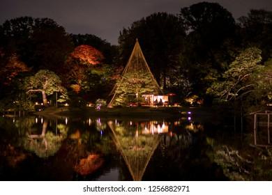"""BUNKYO, TOKYO / JAPAN - NOVEMBER 30 2018 : BUNKYO, TOKYO / JAPAN - NOVEMBER 30 2018 : Night view of """"Rikugi-en Garden"""". Many people visit to see the beautiful Japanese garden lighting up. It is an aut"""