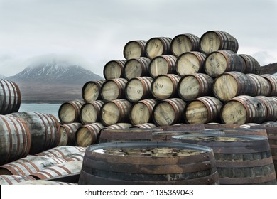 Bunnahabhain distillery, Islay, Scotland. Whisky casks stockpiled outside Bunnahabhain distillery Islay, waiting to be filled. Feb 2017