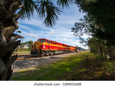 Bunnell, Florida / United States - January 12 2015: Florida East Coast Railway train 210 framed by palms