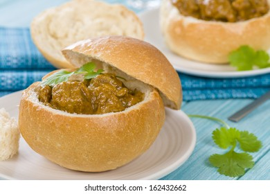 Bunny Chow - South African mutton curry served inside a hollow bread bun.