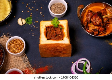Bunny Chow, South African style spicy lamb curry served in the bread pouch