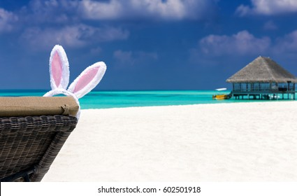 Bunny ears for Easter on sun chair at a beach in the Maldives