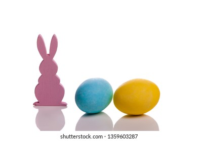 Bunny with easter eggs on a white background - stockphoto