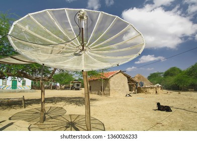 Bunny Village,30,August,2005:   Dish TV  antennas installed outdoor for receiving TV  programmes, in progressive  electrified village,Kutch, Gujarat,India,Asia,