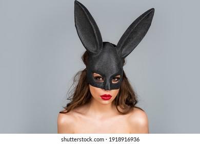 Bunny woman. Beautiful naked girl in fashion bunny mask. Egg hunt. Easter rabbit ears