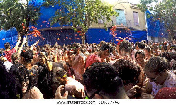 BUNOL, SPAIN - AUGUST 26: La Tomatina festival in August 26, 2015 in Bunol, Spain. Battle of tomatoes at street of city
