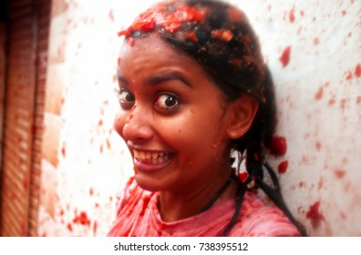 BUNOL, SPAIN - AUGUST 28: The girl in crushed tomatoes laughs on Tomatina festival in Bunol, August 28, 2013 in Spain