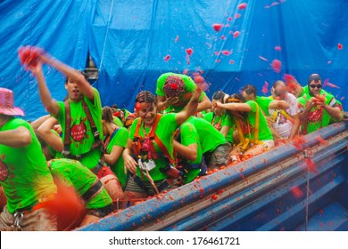 BUNOL, SPAIN - AUGUST 28: La Tomatina festival - tomatoes madness in August 28, 2013 in Bunol, Spain. People are fighting with tomatoes from truck with tomatoes